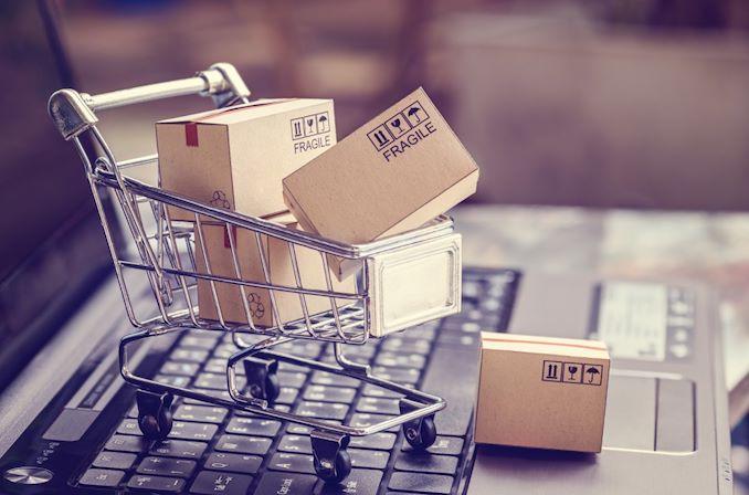 miniature shopping cart on laptop keyboard