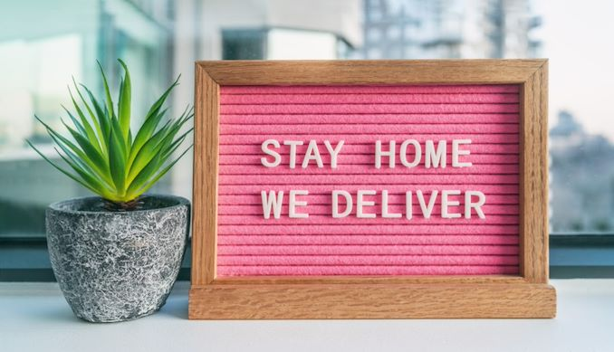 """Sign that says """"stay home we deliver"""""""