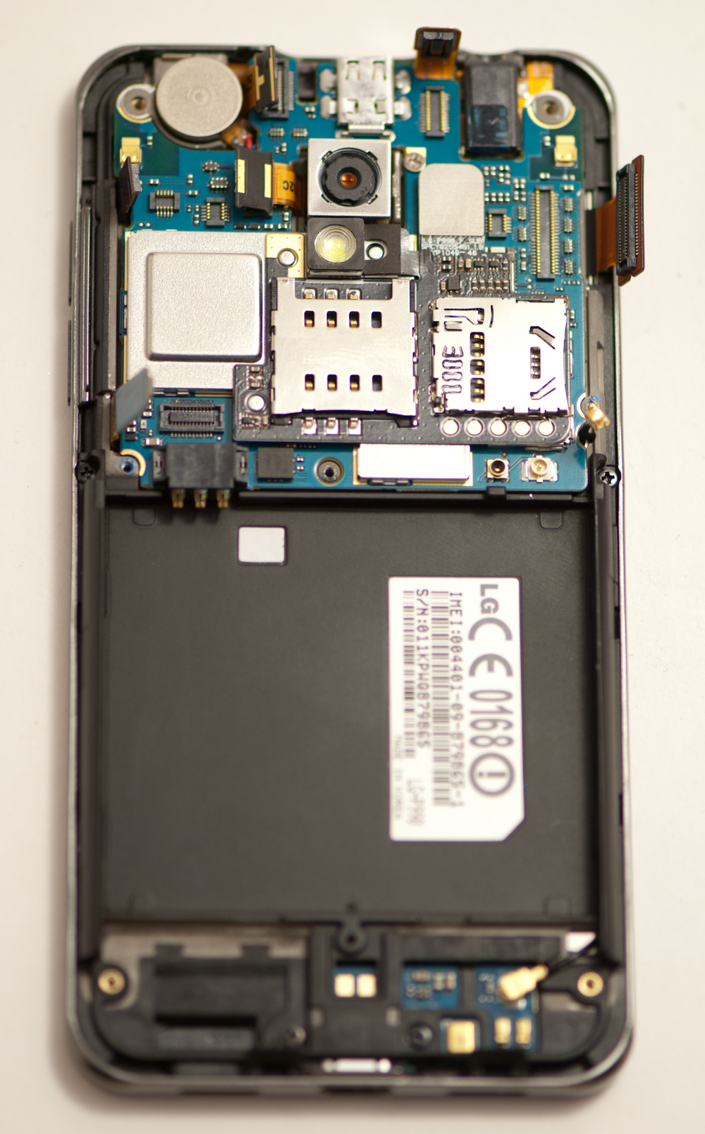 Baseband And Disassembling The Lg Optimus 2x Line Sim Bb9800 Short Circuit For Repair Gsmforum Unscrew Them Then Plastic Covers Easily Pop Out Revealing Interesting Goodies Underneath