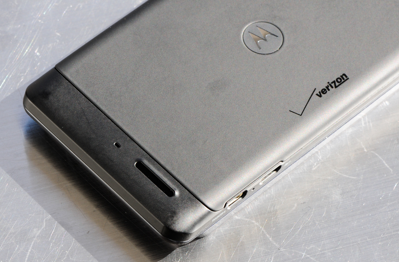 Below That Is The Speakerphone Port, Which Has A Slightly Raised Top Side  To Prevent It From Layingpletely Coplanar And Being Muffled By A Table