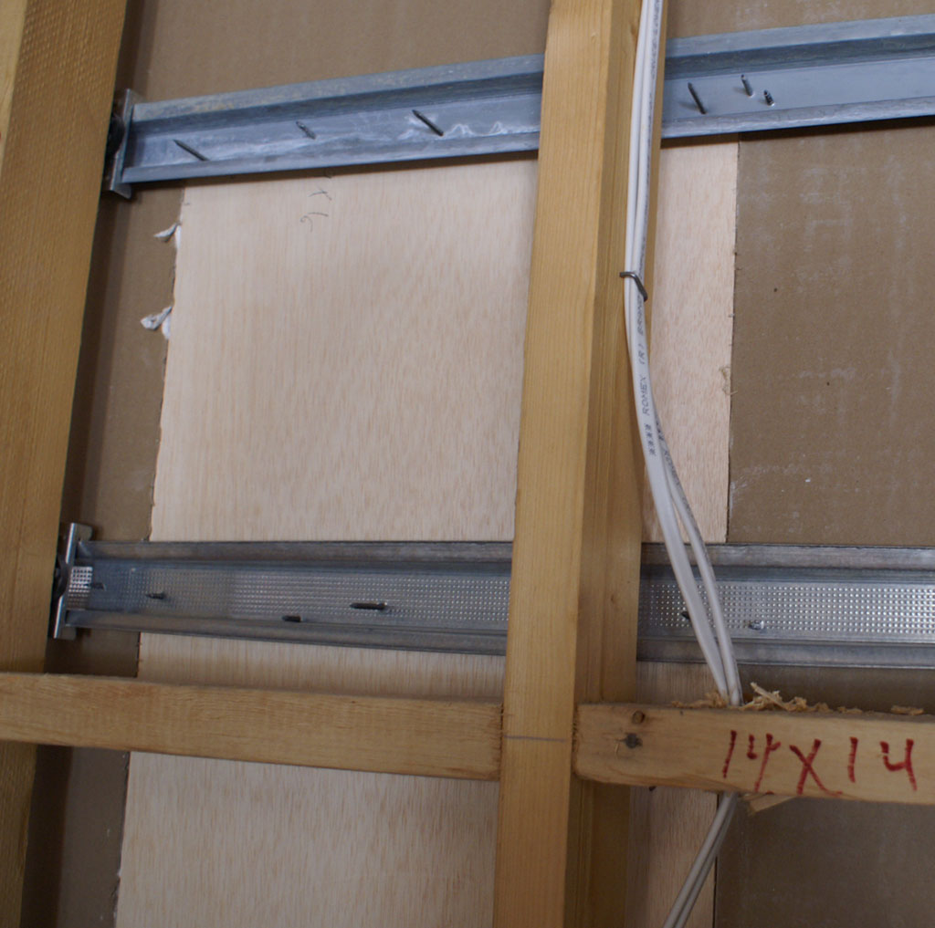 TheaterBlog: Drywall Goes Up, Soundproofing the Room Part II